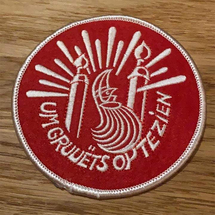 Um grueëts op te zien striek-badge